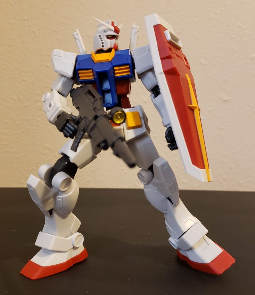 The Gundam adopts a defensive stance.