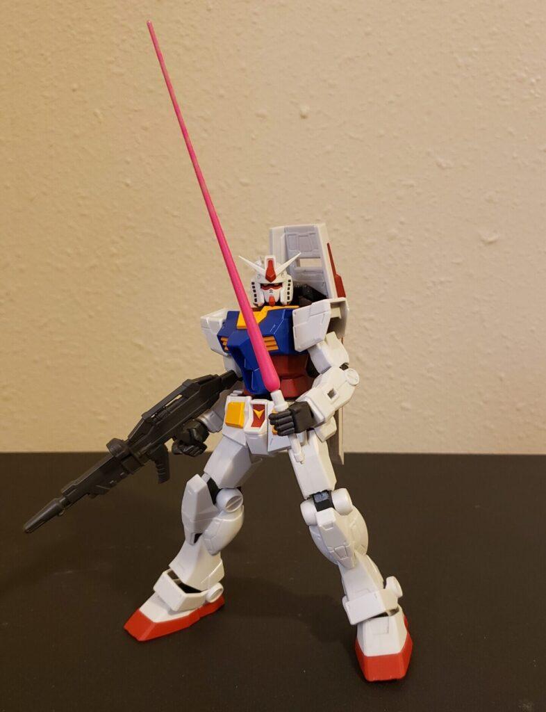 The Gundam ignites a beam saber.