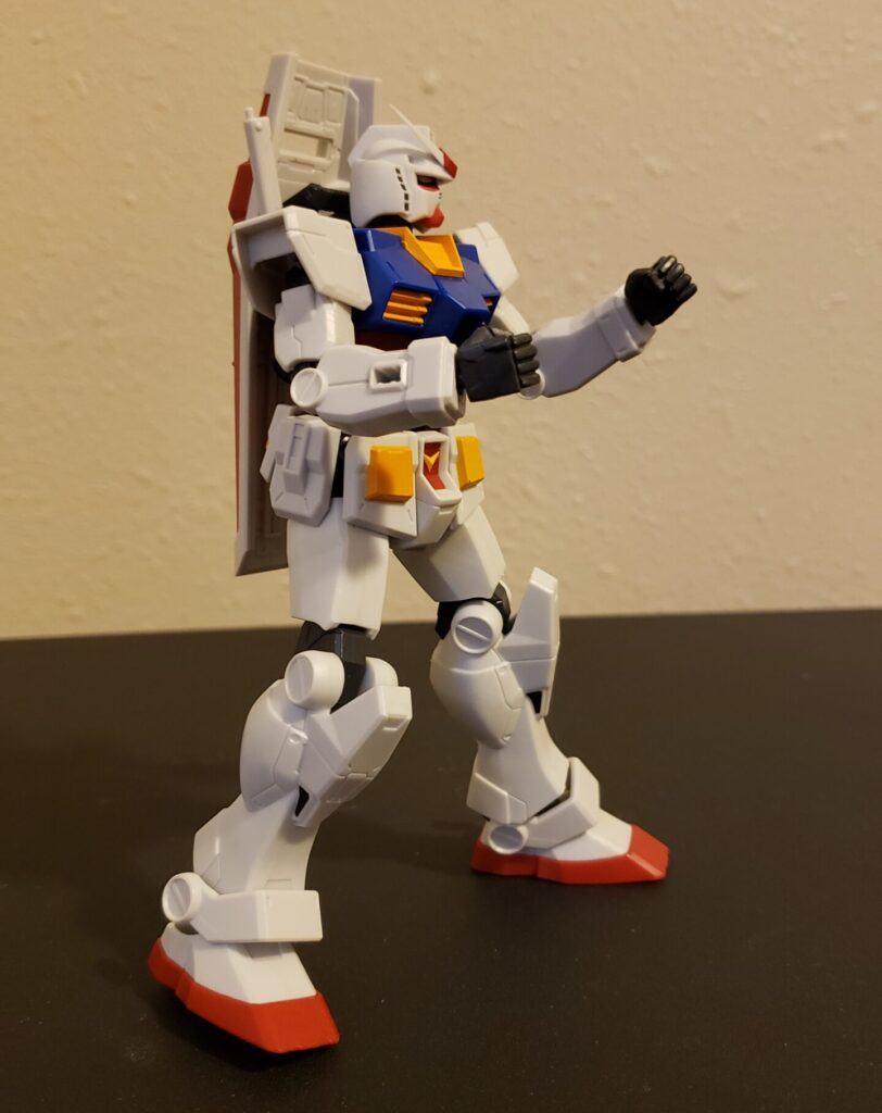 The Gundam posed as though for a fighting game -- hey, anybody up for a round of Battle Assault on the PS1?