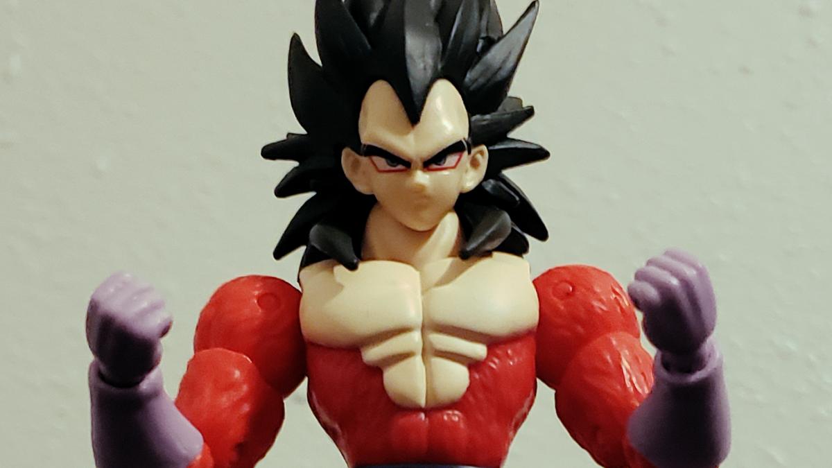 Super Saiyan 4 Vegeta posed as though powering up his ki.